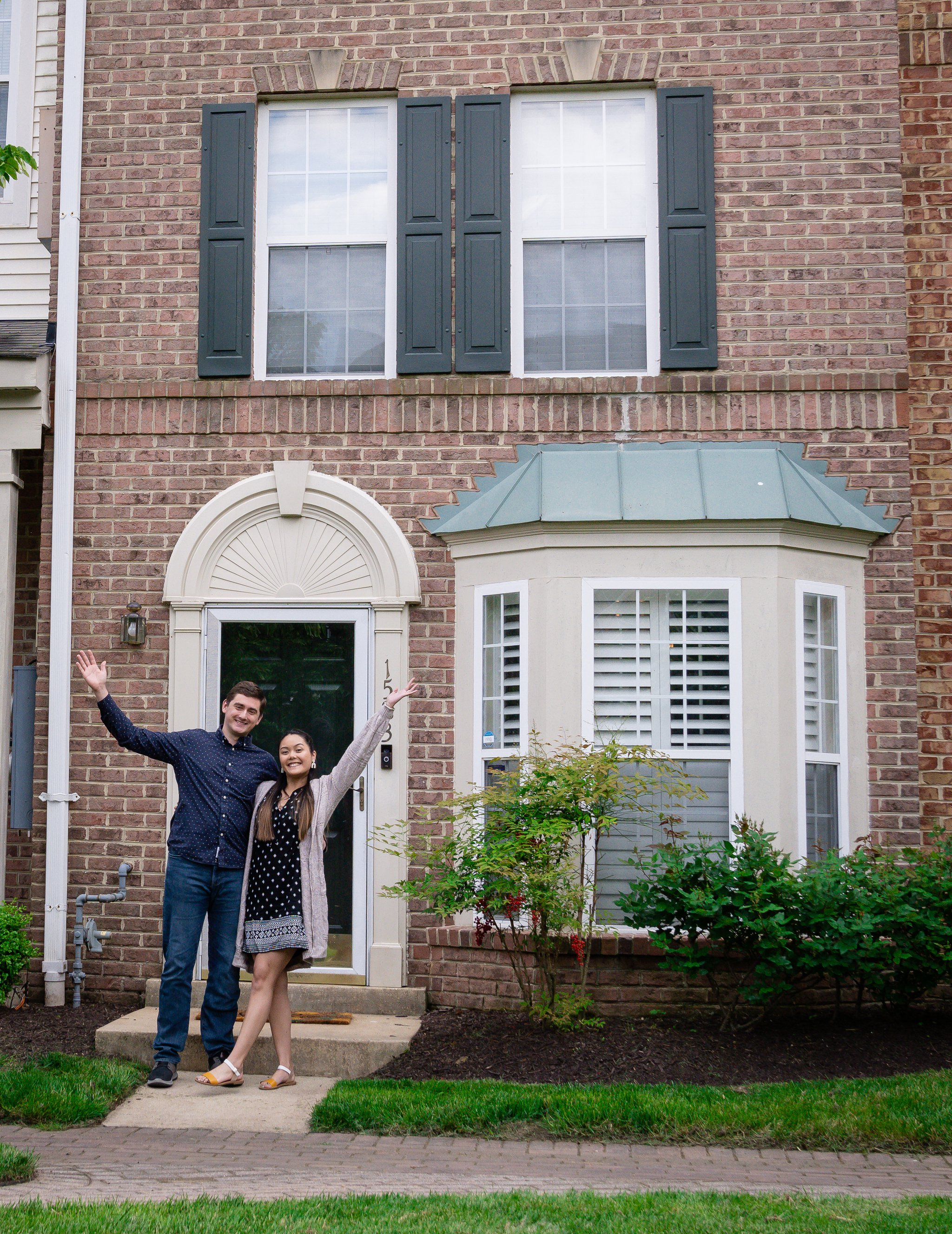 Landed homebuyers Hazel and Joseph in front of their new home outside Washington, DC.