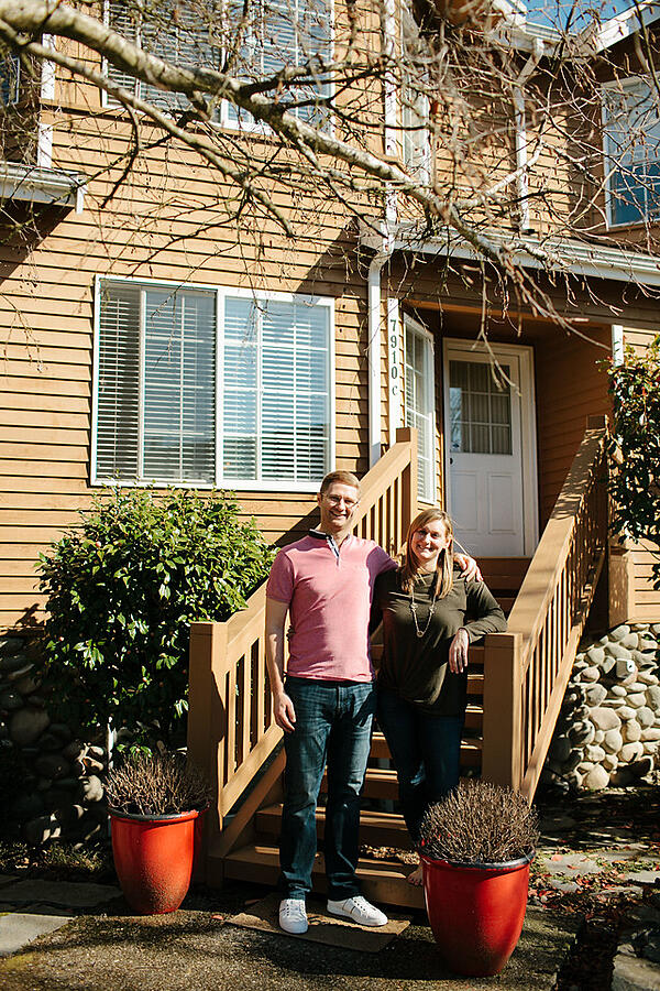 Allie and Brian in front of home