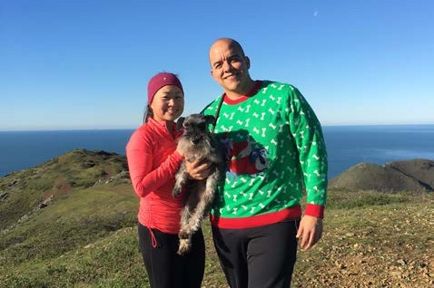 carol-and-fidel-with-their-dog-on-a-hike